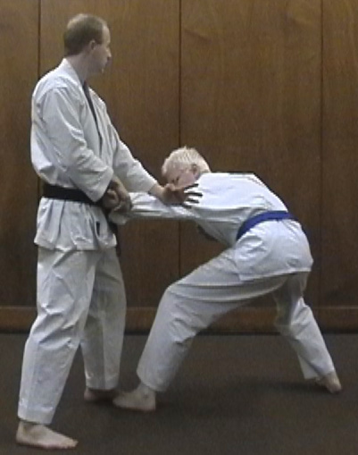 'Downward Sweep' used as an armlock to drive the opponent to the ground