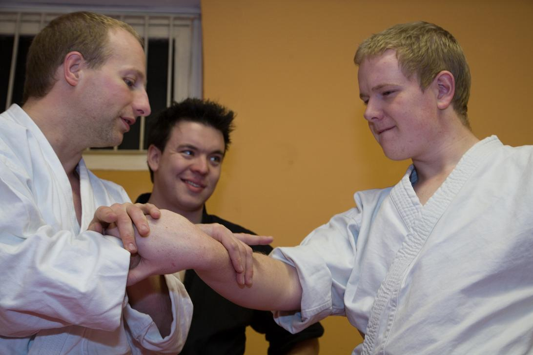 Working on the finer points of the nikyo wrist-lock with students at a seminar in Hull